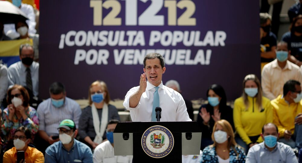 Opposition leader Juan Guaido speaks to the media during a news conference, the day before a popular consultation meant to reject December 6 parliamentary election in Caracas, Venezuela December 11, 2020. REUTERS/Manaure Quintero