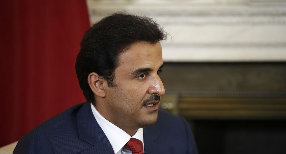 The Emir of Qatar Tamim bin Hamad Al Thani speaks with British Prime Minister Theresa May at the start of their meeting at 10 Downing Street in London, Tuesday, July 24, 2018.