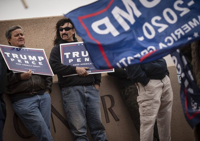 Supporters of President Donald Trump stand outside of the Clark County Elections Department in North Las Vegas, Nev. Saturday, Nov. 7, 2020.
