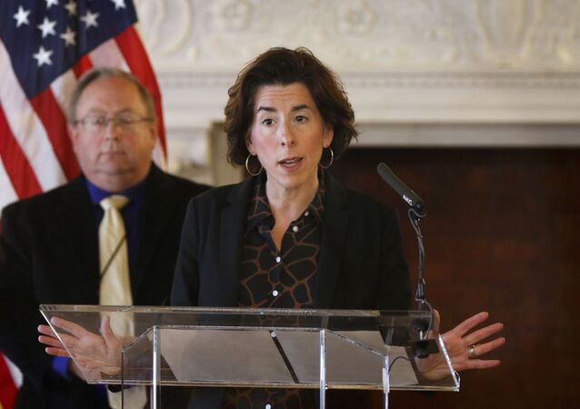 """In this Sunday, March 22, 2020, file photo, Gov. Gina Raimondo gives an update on the coronavirus during a news conference, in Providence, R.I. Many states have yet to spend the federal funding they got to help with soaring costs related to the coronavirus crisis, making it tougher for states and cities to argue that they need hundreds of billions more from U.S. taxpayers. """"If I knew today that another billion dollars was coming to Rhode Island to help solve our budget deficit, I'd spend the $1.25 billion now,"""" Raimondo said about the state's portion of money. """"Lots of other governors are spending. They're taking a gamble, and I'm just not ready to do that yet."""""""