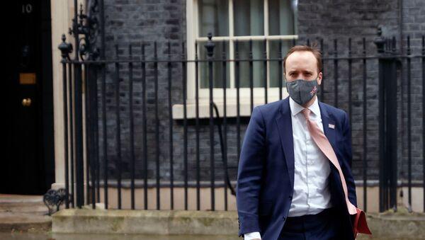 Britain's Health Secretary Matt Hancock leaves Downing Street, in London, Britain, January 4, 2021. - Sputnik International
