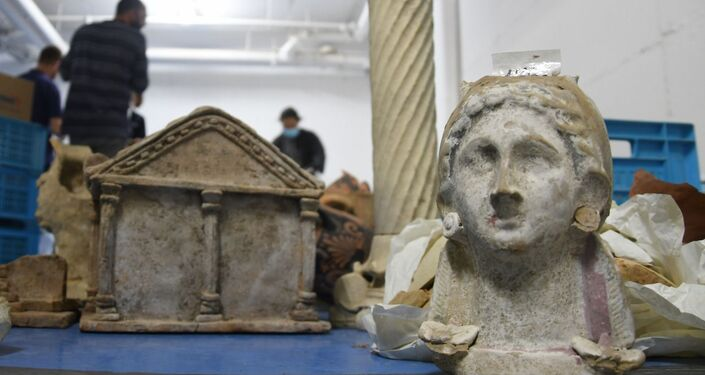 A photo of parts of ancient sculptures discovered during the Israel Antiquities Authority raid in Tel-Aviv, 4 January 2021