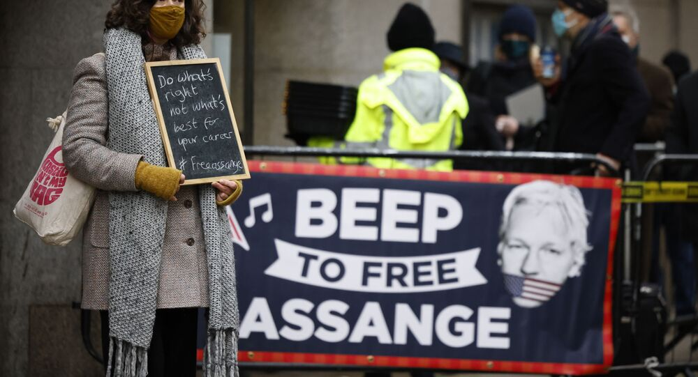 Supporters of Wikileaks founder Julian Assange demonstrate outside the Old Bailey court in central London as the court will rule on his extradition case on January 4, 2021.