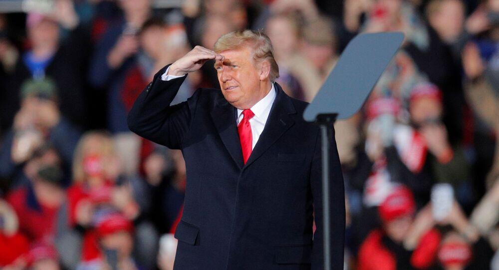 U.S. President Donald Trump looks out as he campaigns with  Republican U.S. Senator Kelly Loeffler  on the eve of Georgia's run-off election in Dalton, Georgia, U.S., January 4, 2021.