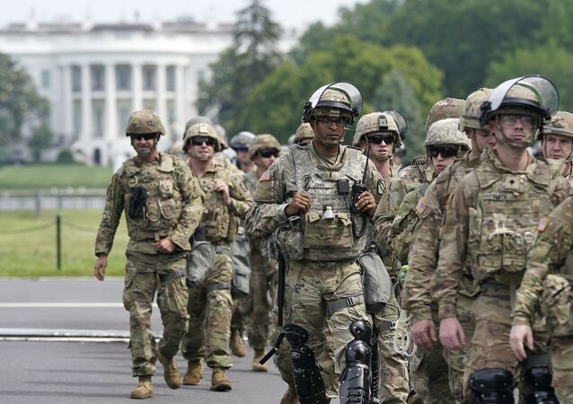 WASHINGTON, DC - JUNE 06: National Guard members deploy near the White House as peaceful protests are scheduled against police brutality and the death of George Floyd, on June 6, 2020 in Washington, DC. People are expected to descend on Washington to participate in peaceful protests in the wake of the death of George Floyd, a black man who was killed in police custody in Minneapolis on May 25.