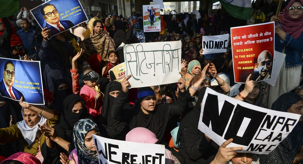 Demonstrators shout slogans and hold placards during a protest against the Indian government's Citizenship Amendment Act (CAA) and the National Register of Citizens (NRC) at Jaffrabad area in New Delhi on February 23, 2020.