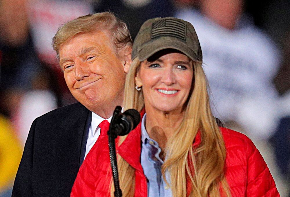 US President Donald Trump poses with Republican Senator Kelly Loeffler as they campaign for her on the eve of the runoff election to decide both of Georgia's Senate seats, in Dalton, Georgia, US, 4 January, 2021.