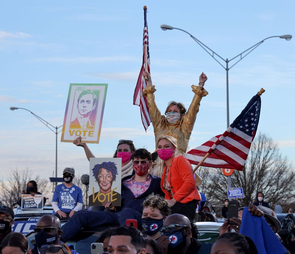 Supporters rally with President-elect Joe Biden as he campaigns for US Senate Democrat candidates Jon Ossoff and Raphael Warnock ahead of runoff elections in Atlanta, Georgia, US, 4 January 2021.