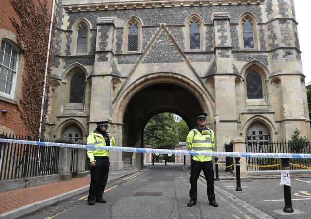 Police officers stand guard outside Forbury Gardens in Reading after three men were stabbed to death in June 2020