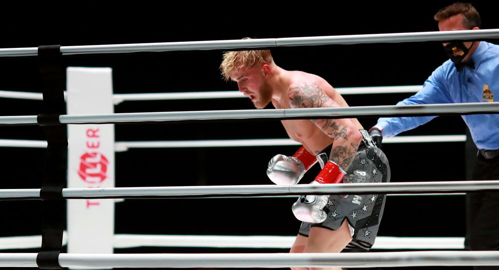 Jake Paul reacts over his knockout victory against Nate Robinson in the second round during Mike Tyson vs Roy Jones Jr. presented by Triller at Staples Center on November 28, 2020 in Los Angeles, California.
