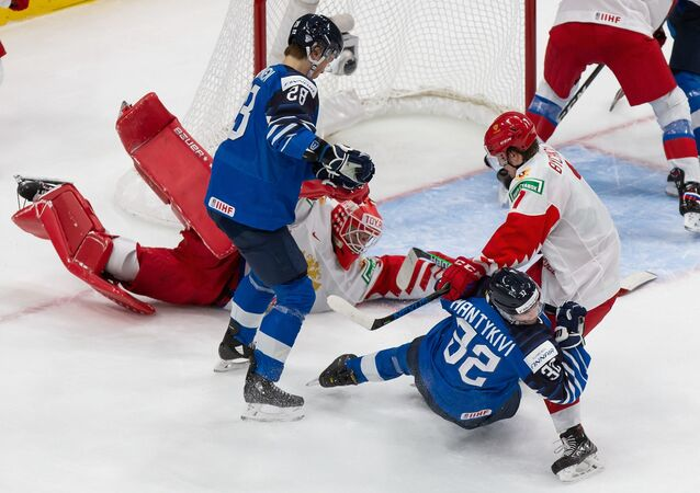 Roman Bychkov #7 of Russia shoves Matias Mantykivi #32 of Finland to the ice during the 2021 IIHF World Junior Championship bronze medal game at Rogers Place on January 5, 2021 in Edmonton, Canada.