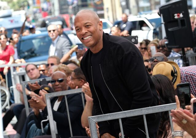 (FILES) In this file photo taken on June 12, 2017 Rapper/producer Dr. Dre attends Ice Cube's Walk of Fame ceremony in Hollywood, California.