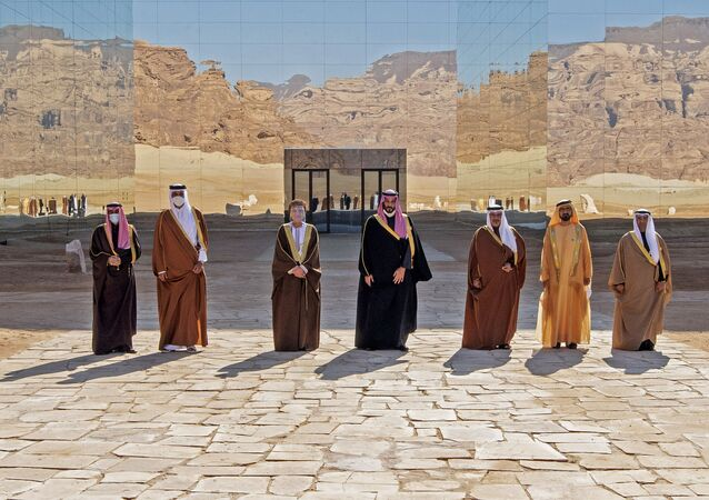 A handout picture provided by the Saudi Royal Palace on January 5, 2021, shows from L to R: Kuwaiti Emir Sheikh Nawaf al-Ahmad Al-Sabah, Emir of Qatar Tamim bin Hamad Al-Thani, Omani Deputy Prime Minister Fahd Bin Mahmud, Saudi Crown Prince Mohammed bin Salman, Bahrain's Crown Prince Salman bin Hamad Al-Khalifa, Dubai's Ruler and UAE Vice President Sheikh Mohammed bin Rashid Al-Maktoum and Nayef al-Hajraf, secretary-general of the Gulf Cooperation Council (GCC) posing for a pictures before the opening session of the 41st Gulf Cooperation Council (GCC) summit in the northwestern Saudi city of al-Ula. - Saudi Arabia's Crown Prince Mohammed bin Salman said that the Gulf states had signed an agreement on regional solidarity and stability at a summit aimed at resolving a three-year embargo against Qatar.