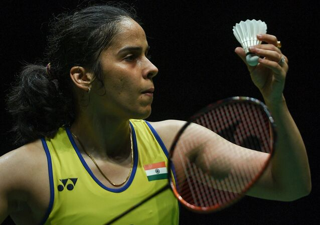 India's Saina Nehwal serves against Spain's Carolina Marin during their women singles quarter-final match at the Malaysia Open badminton tournament in Kuala Lumpur on January 10, 2020.