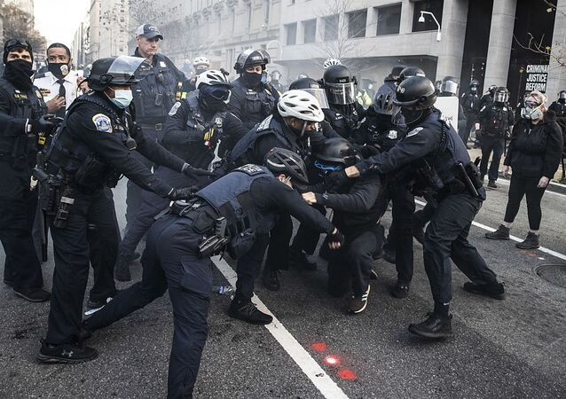 Protesters clash with Washington DC Police at Black Lives Matter Plaza on 12 December 2020 in Washington, DC.
