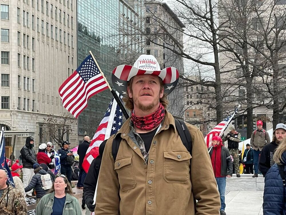A Trump supporter takes part in a rally in DC as demonstrators demand a recount of votes and a review of election results in a number of states.