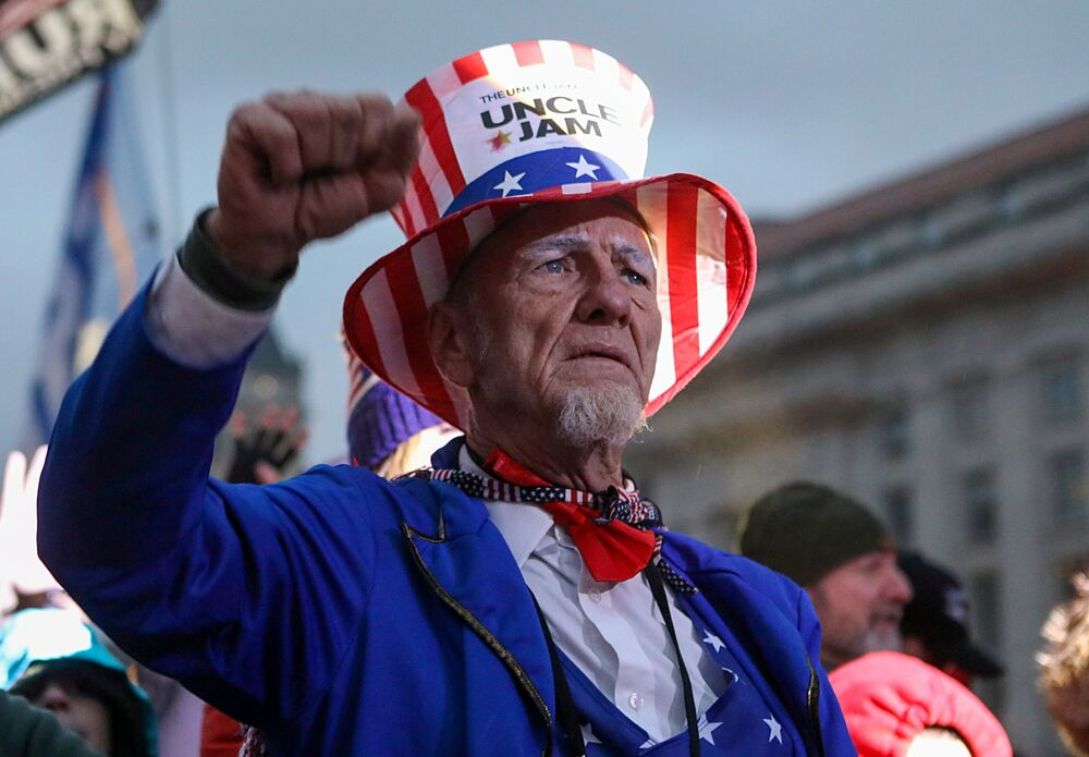 A pro-Trump demonstrator reacts during a rally in Freedom Plaza, ahead of the U.S. Congress certification of the November 2020 election results, 5 January, 2021.
