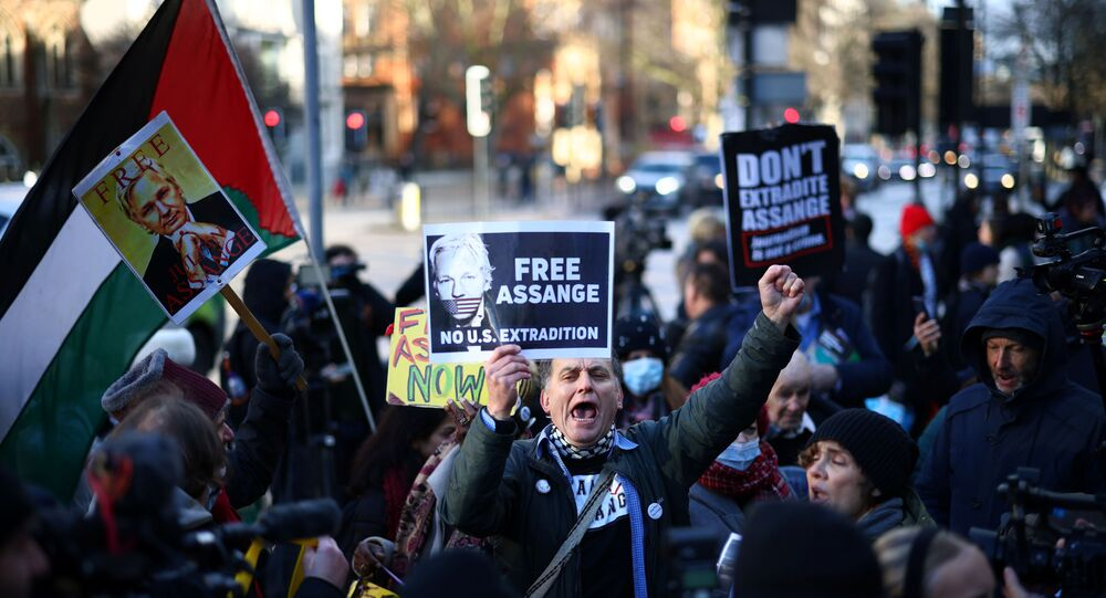 Protesters holding placards demonstrate outside the Westminster Magistrates' Court as Julian Assange's lawyers seek bail for their client in London, Britain 6 January 2021.