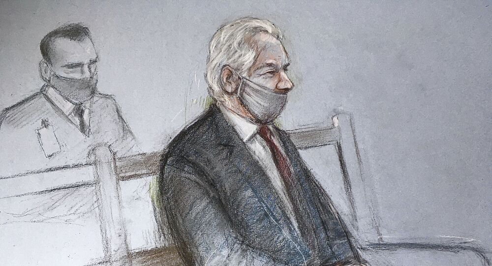 """This is a court artist sketch by Elizabeth Cook of Julian Assange appearing at the Old Bailey in London for the ruling in his extradition case, in London, Monday, Jan. 4, 2021. A British judge has rejected the United States' request to extradite WikiLeaks founder Julian Assange to face espionage charges, saying it would be """"oppressive"""" because of his mental health. District Judge Vanessa Baraitser said Assange was likely to kill himself if sent to the U.S. The U.S. government said it would appeal the decision.  (Elizabeth Cook/PA via AP)"""
