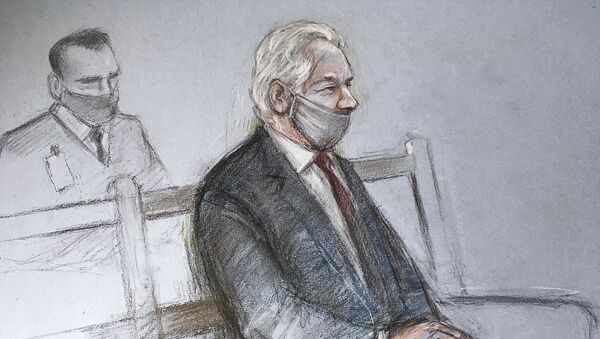 """This is a court artist sketch by Elizabeth Cook of Julian Assange appearing at the Old Bailey in London for the ruling in his extradition case, in London, Monday, Jan. 4, 2021. A British judge has rejected the United States' request to extradite WikiLeaks founder Julian Assange to face espionage charges, saying it would be """"oppressive"""" because of his mental health. District Judge Vanessa Baraitser said Assange was likely to kill himself if sent to the U.S. The U.S. government said it would appeal the decision.  (Elizabeth Cook/PA via AP) - Sputnik International"""