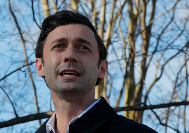 Democratic candidate for the U.S. Senate Jon Ossoff speaks to reporters outside the Georgia run-off election polling site at the Dunbar Neighborhood Center in Atlanta, Georgia, U.S., January 5, 2021.