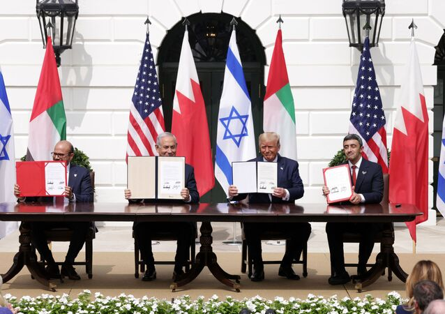 (L-R) Foreign Affairs Minister of Bahrain Abdullatif bin Rashid Al Zayani, Prime Minister of Israel Benjamin Netanyahu, U.S. President Donald Trump, and Foreign Affairs Minister of the United Arab Emirates Abdullah bin Zayed bin Sultan Al Nahyan participate in the signing ceremony of the Abraham Accords on the South Lawn of the White House on September 15, 2020 in Washington, DC.