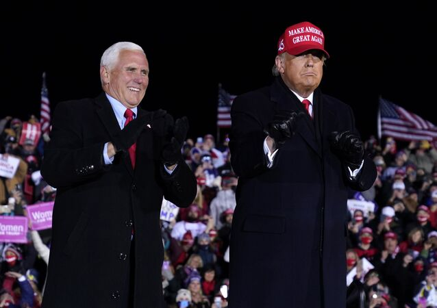 President Donald Trump and Vice President Mike Pence smile after a campaign rally at Gerald R. Ford International Airport, early Tuesday, Nov. 3, 2020, in Grand Rapids, Mich