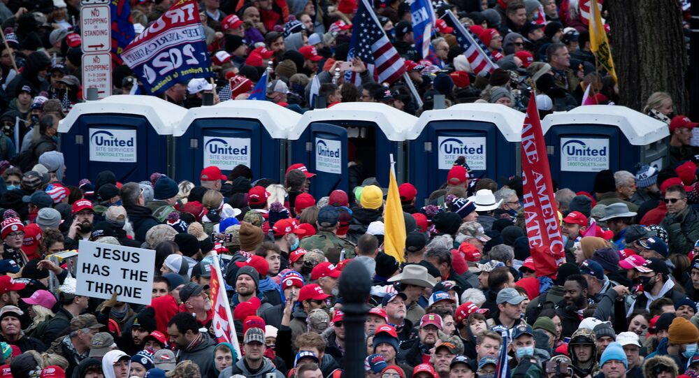 People wait on the National Mall outside a security perimeter for a rally of supporters of US President Donald Trump challenging the results of the 2020 US Presidential election on the Ellipse on January 6, 2021 in Washington, DC.