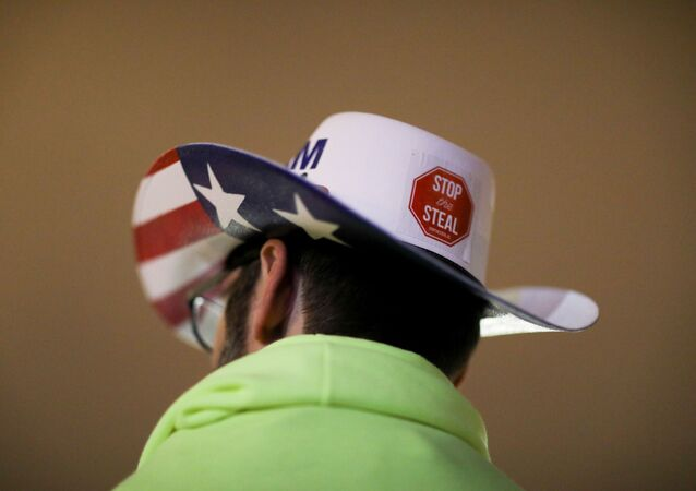 A supporter of U.S. President Donald Trump wearing a hat with a sticker on it reading Stop the Steal attends a rally ahead of the U.S. Congress certification of the November 2020 election results, during protests in Washington, U.S., January 5, 2021.