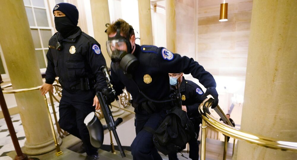 US Capitol police officers take positions as protesters enter the Capitol building during a joint session of Congress to certify the 2020 election results on Capitol Hill in Washington, US, 6 January 2021.