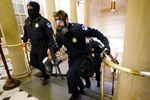 U.S. Capitol police officers take positions as protestors enter the Capitol building during a joint session of Congress to certify the 2020 election results on Capitol Hill in Washington, U.S., January 6, 2021.