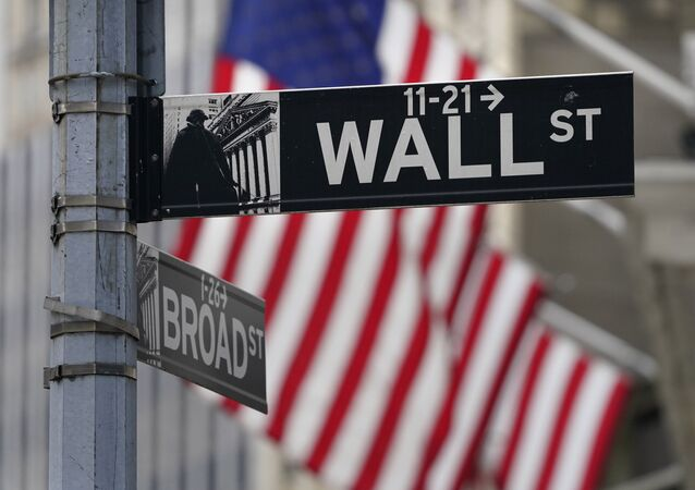 In this Nov. 23, 2020, photo, a street sign is displayed at the New York Stock Exchange in New York. S&P DJ Indices is removing 21 Chinese companies from its indexes, or groups of stocks and bonds used to track financial market movements, after Americans were barred from investing in them as part of a feud with Beijing over technology and security.