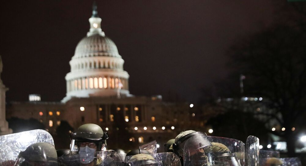 Members of the National Guard stand guard as supporters of U.S. President Donald Trump gather outside the U.S. Capitol building during a protest against the certification of the 2020 U.S. presidential election results by the U.S. Congress, in Washington, U.S., January 6, 2021.