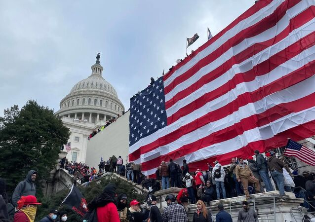 Demonstrators protest outside US Capitol Building in Washington to contest the certification of the 2020 presidential election results by the US Congress, 6 January 2021