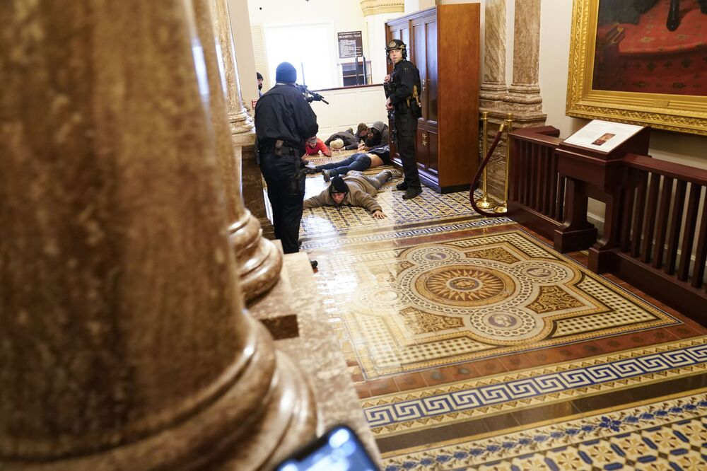 US Capitol Police hold protesters at gun-point near the House Chamber inside the US Capitol on Wednesday, 6 January 2021, in Washington