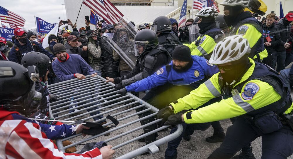 Trump supporters try to break through a police barrier, Wednesday, Jan. 6, 2021, at the Capitol in Washington