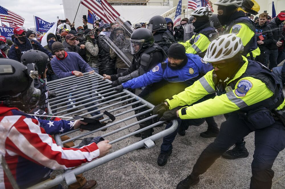 Trump supporters try to break through a police barrier, Wednesday, 6 January 2021, at the Capitol in Washington