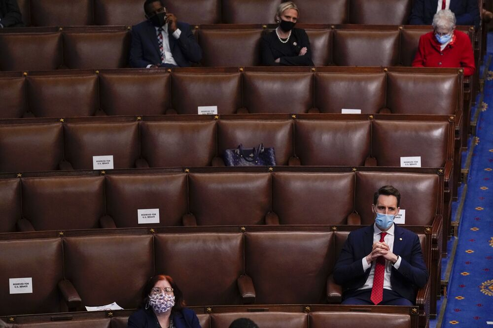 Sen. Josh Hawley, R-Mo., listens as a joint session of the House and Senate reconvenes to confirm the Electoral College votes at the Capitol, Wednesday, 6 January 2021