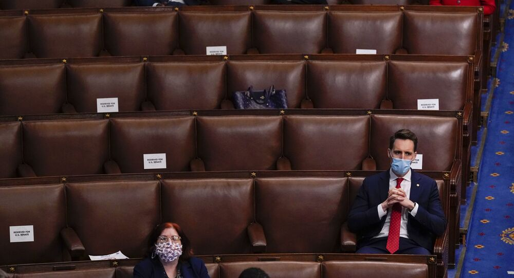 Republican Senator Josh Hawley of Missouri listens as a joint session of the House and Senate reconvenes to confirm the Electoral College votes at the Capitol, Wednesday, 6 January 2021.
