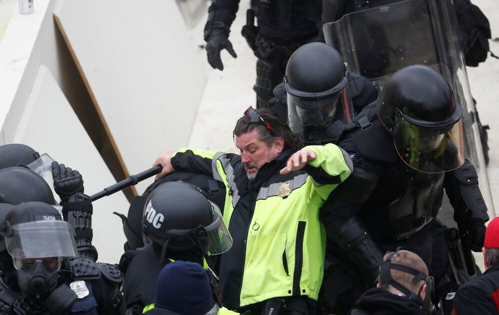 Police officers clash with pro-Trump protesters, during a rally to contest the certification of the 2020 US presidential election results by the US Congress, at the US Capitol Building in Washington, US, January 6, 2021