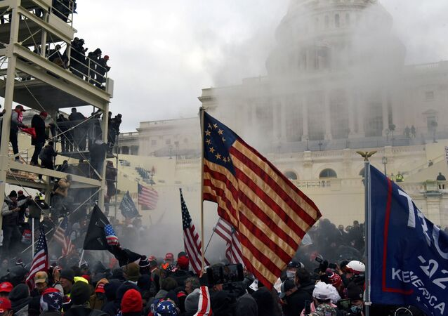 Supporters of US President Donald Trump protest in front of the U.S. Capitol Building in Washington, DC, 6 January 2021.