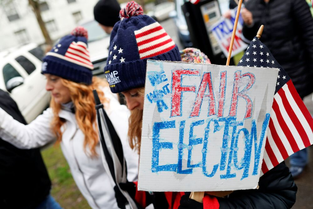 Above: A protester holds a sign saying We want a fair election at a rally in support of US President Donald Trump at the Oregon State Capitol in Salem, Oregon, US, 6 January 2021