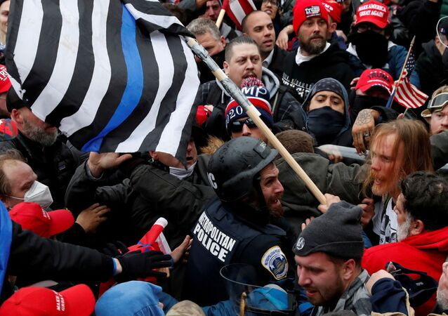 Pro-Trump protesters clash with police at a rally to contest the certification of the 2020 US presidential election results by the US Congress, at the US Capitol Building in Washington, DC, 6 January 2021
