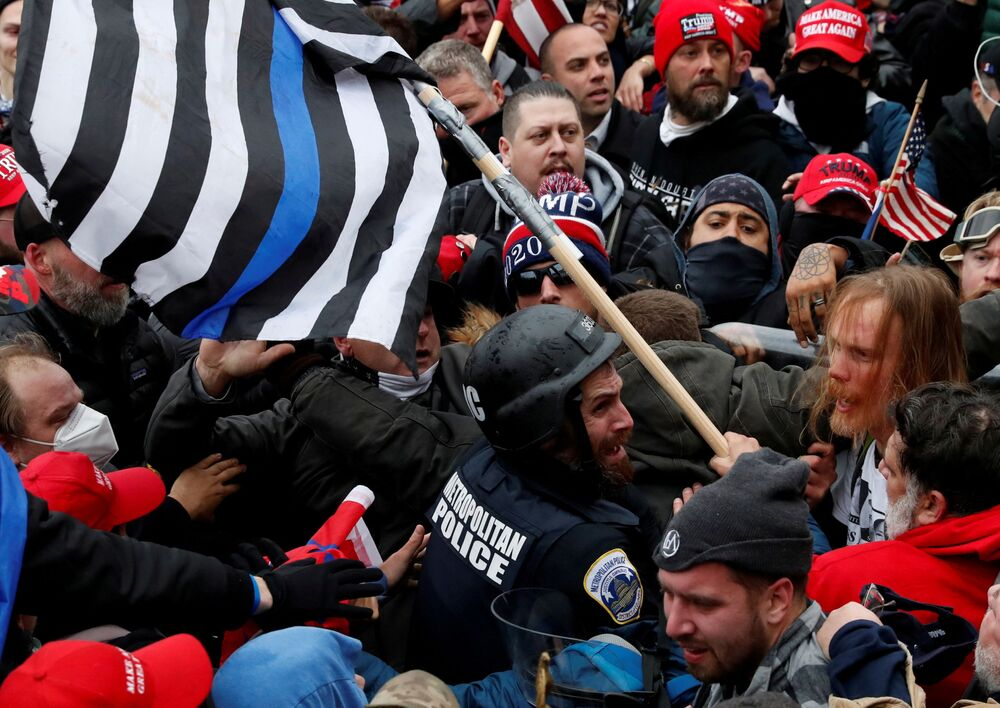 Pro-Trump protesters clash with police at a rally to contest the certification of the 2020 US presidential election results by the US Congress, at the US Capitol Building in Washington, US, 6 January 2021