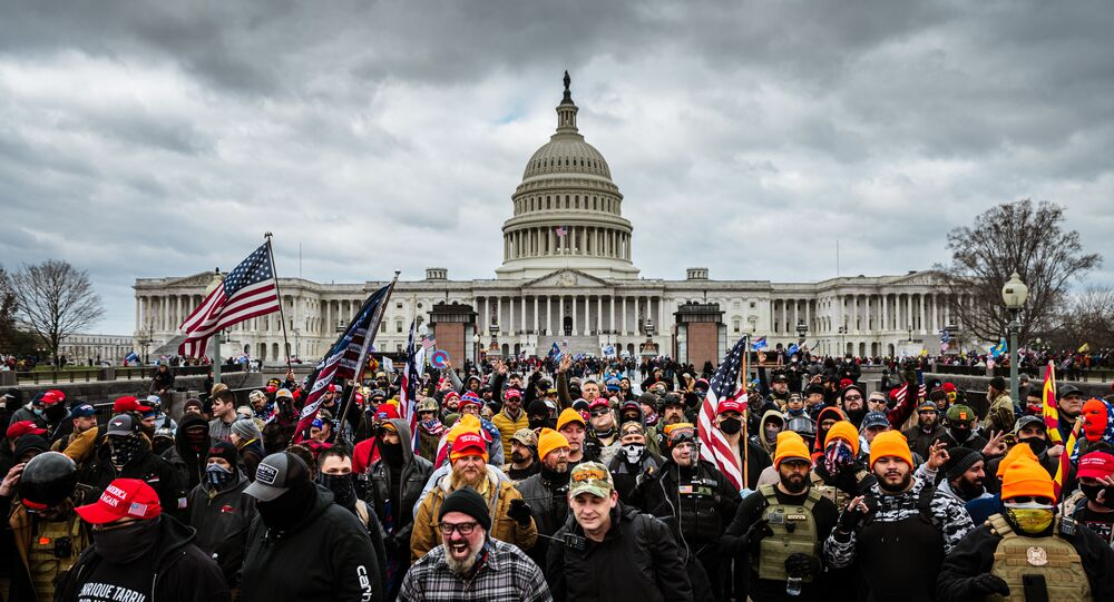 Pro-Trump protesters gather in front of the U.S. Capitol Building on 6 January 2021 in Washington, DC. A pro-Trump mob stormed the Capitol, breaking windows and clashing with police officers.