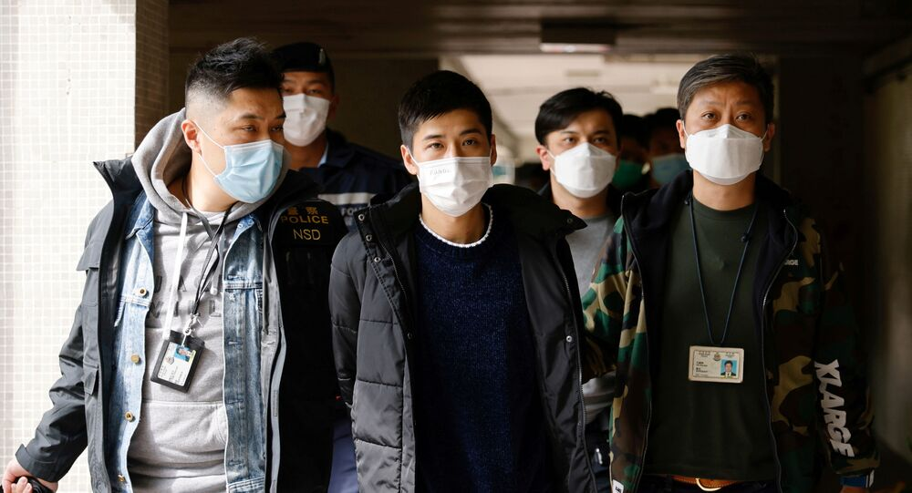Pro-democracy activist Lester Shum is taken away by police officers after over 50 Hong Kong activists arrested under security law as crackdown intensifies, in Hong Kong, China January 6, 2021.
