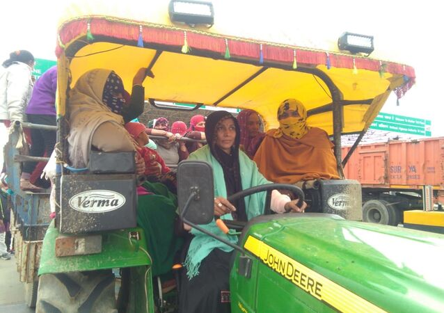 Sikkim Nain Driving Tractor With Women Supporters