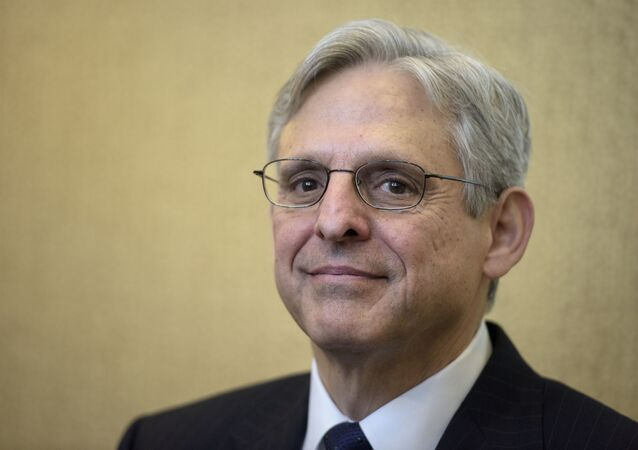In this file photo taken on March 28, 2016, US Supreme Court nominee Judge Merrick Garland waits for a meeting with US Senator Benjamin Cardin on Capitol Hill in Washington, DC. - President-elect Joe Biden has selected Garland as his attorney general, officials familiar with the selection process said on January 6, 2021. Biden is expected to announce Garland's appointment on January 7.