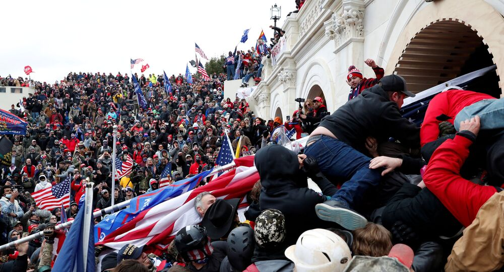 Pro-Trump protesters storm into the US Capitol during clashes with police, during a rally to contest the certification of the 2020 US presidential election results by the US Congress, in Washington, US, 6 January 2021