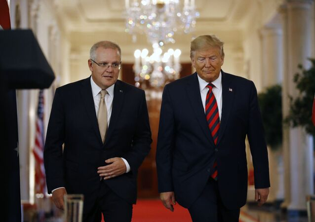 President Donald Trump and Australian Prime Minister Scott Morrison arrive for a news conference in the East Room of the White House, Friday, Sept. 20, 2019, in Washington.